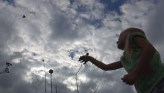Child Playing with Kite on Meadow, Little Girl Flying a Dragon in Sky, Children - stock footage