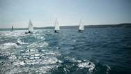 Stock Video Footage of Sailboats on wild sea at midday