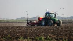 0089 Tractor at work in a farm land Stock Footage