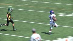 Youth League Football- Running Back Touchdown Stock Footage