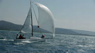 Stock Video Footage of Three people on sailboat enjoying the sailing on beautiful day