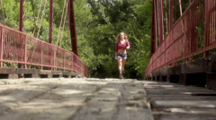 Stock Video Footage of country bridge -pretty redhead walking on old bridge