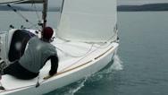 Stock Video Footage of Close up on sailboat sailors sailing through sea