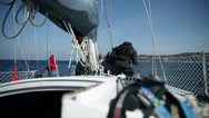 Stock Video Footage of Onboard shot of sailors on sailboat while sailing on sea