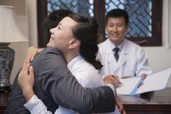 Patient and Spouse Hug at the Good News Stock Photos