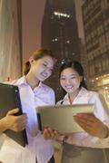 Young businesswomen working outdoor - stock photo