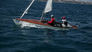 Stock Video Footage of Two sailors on small sailboat at great weather