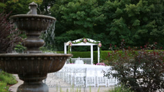 Fountain at august wedding ceremony focus on gazebo Stock Footage