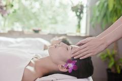 Women Receiving Head Massage - stock photo