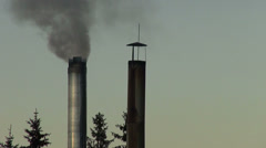 Black smoke coming out from a metal chimney stack, clear sky, pollution Stock Footage