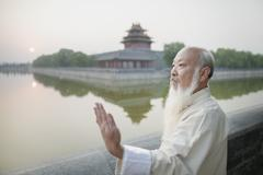 Stock Photo of Senior Man Practicing Tai Ji