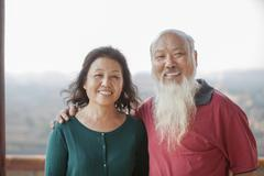 Portrait Of Smiling Old Couple In Jing Shan Park Stock Photos