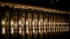 Boston plaza night across reflecting pool wide Stock Footage