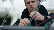 Stock Video Footage of Close up on sailor preparing ropes for main sail