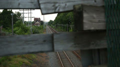 Railroad to broken wood fence rack focus in and out Stock Footage
