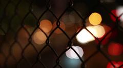 chain link defocused headlights - stock footage