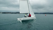 Stock Video Footage of Following sailboat while sailing through sea