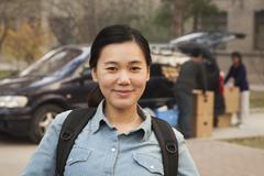 Student portrait in front of dormitory at college Stock Photos