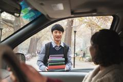 Family dropping off their son at college Stock Photos