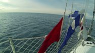 Stock Video Footage of Flags waving on a sailing boat at sea
