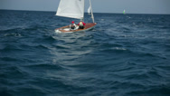 Stock Video Footage of Sailboat in wild sea waters at windy weather
