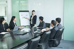 Stock Photo of Business people having meeting