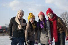 Friends on ice rink - stock photo