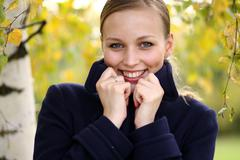 Stock Photo of Autumn young blonde woman