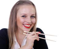 girl with sticks for the chinese meal - stock photo