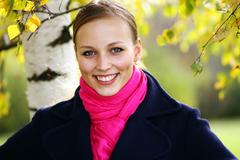 Autumn young blonde woman - stock photo