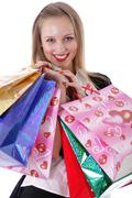 Happy young adult woman with colored bags Stock Photos