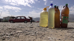 Fuel in bottles along the roadside, Lada, Uzbekistan Stock Footage