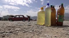 Fuel in bottles along the roadside, Lada, Uzbekistan Stock Footage