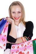 happy young adult woman with colored bags - stock photo