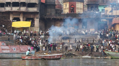 Burning Ghat on the Banks of the Ganges River in Varanasi, India Stock Footage
