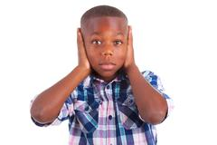 african american boy hiding ears  - black people - stock photo