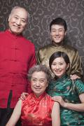 Stock Photo of Portrait of grandparents and adult grandchildren in traditional Chinese clothing