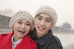 Stock Photo of Portrait of young couple outdoors in wintertime, Beijing