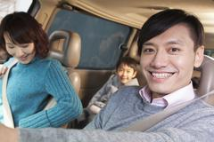 Family sitting in car, Beijing - stock photo