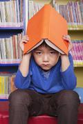 Unhappy Boy with Book - stock photo