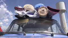 Old Lada packed with carpets, former Soviet Union, Central Asian Republic - stock footage