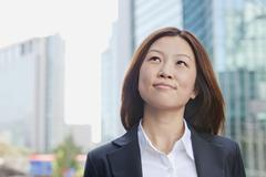 Smiling Young Businesswoman Looking Away - stock photo