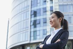 Low Angle of a Young Businesswoman Smiling Stock Photos