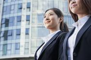 Stock Photo of Two Businesswomen In Front of CityScape