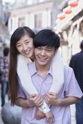 Stock Photo of Portrait of Young Heterosexual Couple Embracing Outdoors in Beijing