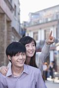 Stock Photo of Young Heterosexual Couple Pointing Outdoors in Beijing