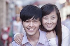 Stock Photo of Portrait of Young Heterosexual Couple Smiling in Beijing
