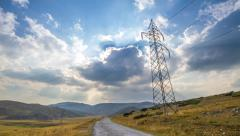 4K scenery with electrical pylon and time-lapsed cloudy sky Stock Footage