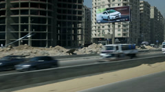 Traveling through cityscape on highway in Egypt Stock Footage