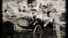 529 - young cowboy takes children on carriage ride - vintage film home movie Stock Footage